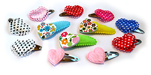 Vrolijke haarspeldjes en haarknipjes voor baby, peuter en kleuter met hartjes
