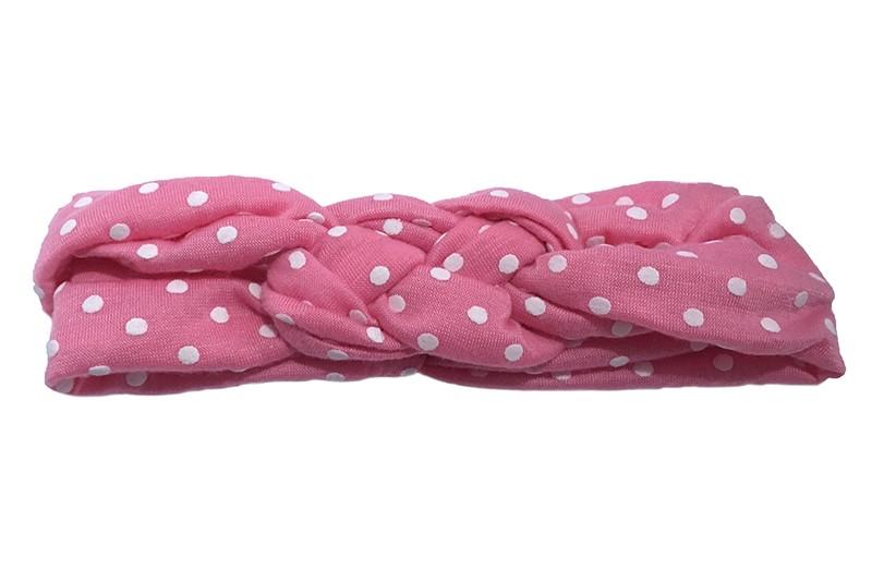Lief roze baby peuter haarbandje met witte stippeltjes. Dubbel in elkaar geknoopt, van rekbare stof. Heeft, zonder uit te rekken, een omtrek van ongeveer 34 centimeter.