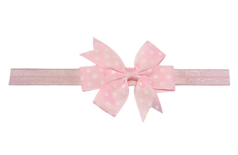 Vrolijk licht roze baby haarbandje. Met een licht roze strik met witte stippeltjes. De strik is ongeveer 8 centimeter.  Het haarbandje is van rekbaar elastiek. Niet uitgerekt is het haarbandje ongeveer 17 centimeter.
