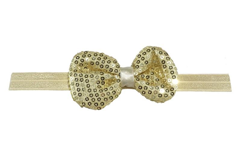 Leuk elastische baby haarbandje creme/goud. Met daarop een stoffen strikje met kleine pailletjes. Het strikje is ongeveer 8.5 centimeter. Niet uitgerekt gemeten is het haarbandje ongeveer 17 centimeter.