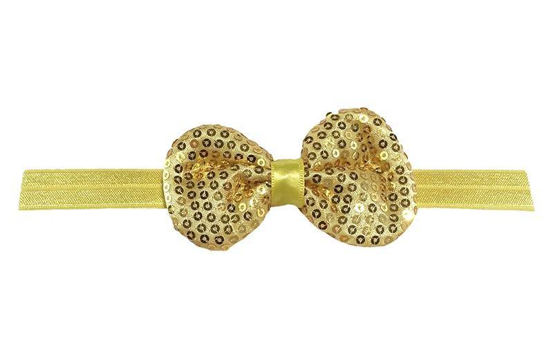 Leuk elastische baby haarbandje geelgoud. Met daarop een stoffen strikje met kleine pailletjes. Het strikje is ongeveer 8.5 centimeter. Niet uitgerekt gemeten is het haarbandje ongeveer 17 centimeter.