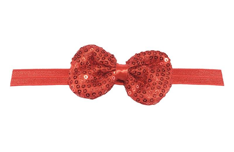 Leuk elastische baby haarbandje rood. Met daarop een rood stoffen strikje met kleine pailletjes. Het strikje is ongeveer 8.5 centimeter. Niet uitgerekt gemeten is het haarbandje ongeveer 17 centimeter.