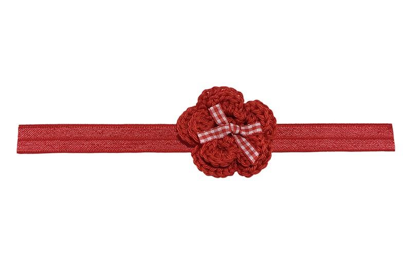 Vrolijk rood baby haarbandje met een rode gehaakte bloem.  Afgewerkt met een vrolijk rood wit strikje. Het haarbandje is van rekbaar elastiek. Niet uitgerekt is het haarbandje ongeveer 18.5 centimeter breed.