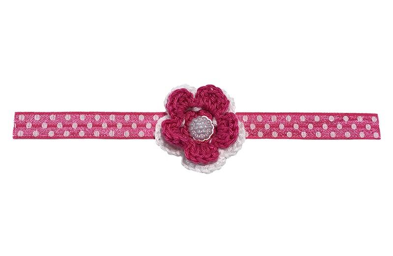 Vrolijk roze wit gestippeld baby haarbandje met daarop een roze wit gehaakte bloem.  Afgewerkt met een wit pareltje.  Het haarbandje is van rekbaar elastiek. Neit uitgerekt is het haarbandje ongeveer 18.5 centimeter.