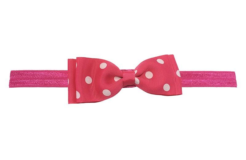 Vrolijk roze baby haarbandje. Met een roze strikje met witte stippeltjes. Het strikje is ongeveer 9.5 centimeter.  Het haarbandje is van rekbaar elastiek. Niet uitgerekt is het haarbandje ongeveer 16.5 centimeter.