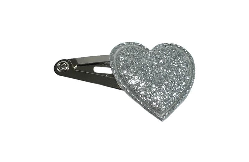 Vrolijk baby haarspeldje met een zilver glitter hartje.