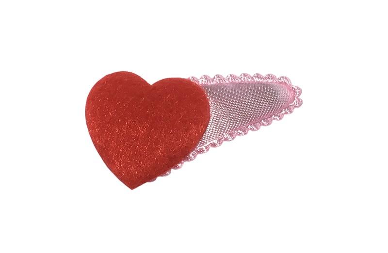 Vrolijk licht roze baby peuter haarspeldje met een rood fluffie hartje