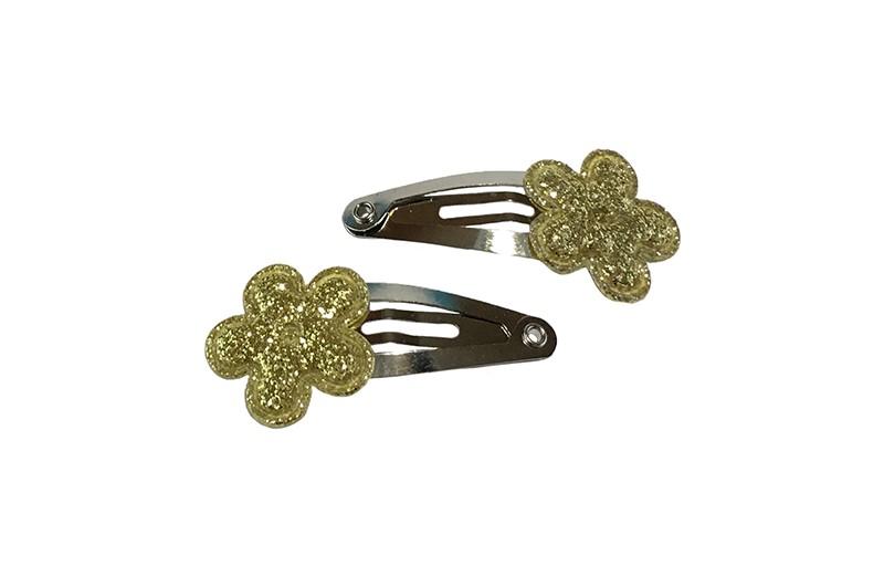 Schattig setje van 2 kleine baby haarspeldjes. Met op elk een klein goud glitter bloemetje.