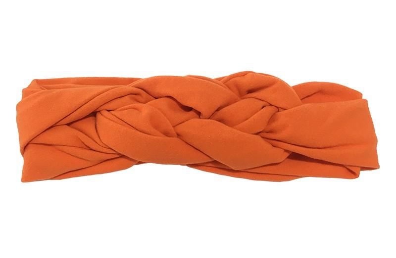 Leuk effen oranje baby peuter haarbandje. In een leuk dubbel in elkaar geknoopt modelletje. Van zachte rekbare stof.  De breedte van het haarbandje is ongeveer 5.5 centimeter.