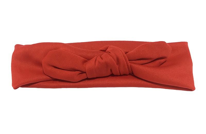 Leuk rood baby peuter haarbandje van glanzende rekbare gladde stof. Het haarbandje is in een leuk 'konijnenoortjes model' geknoopt.  De hoogte van het haarbandje is ongeveer 5 centimeter.
