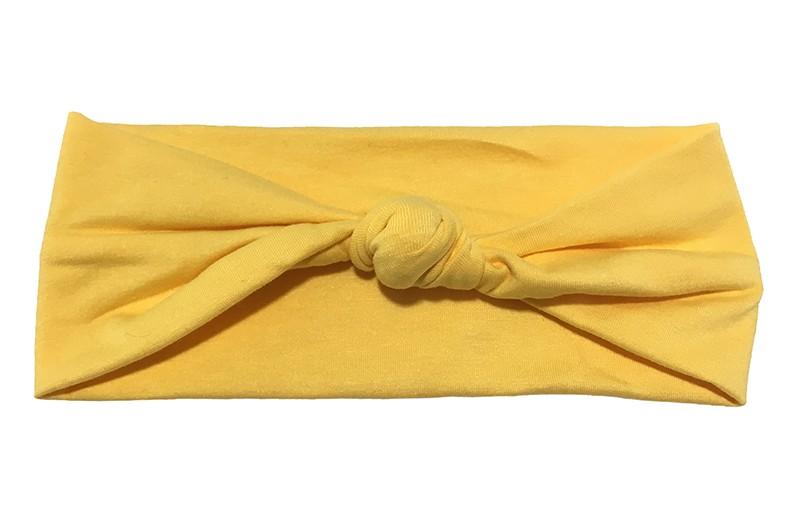 Leuk effen geel geknoopt baby peuter haarbandje van zachte stof.