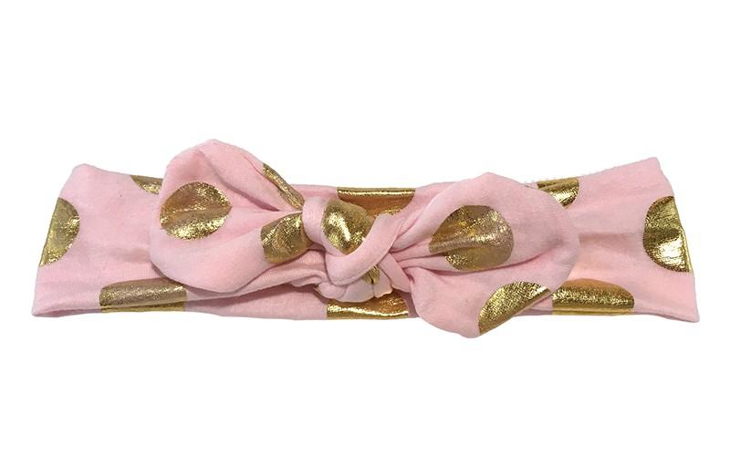 Leuk licht roze baby peuter haarbandje met glanzend gouden stippen. Dit haarbandje is van zachte rekbare stof, geknoopt in 'konijnenoortjes'