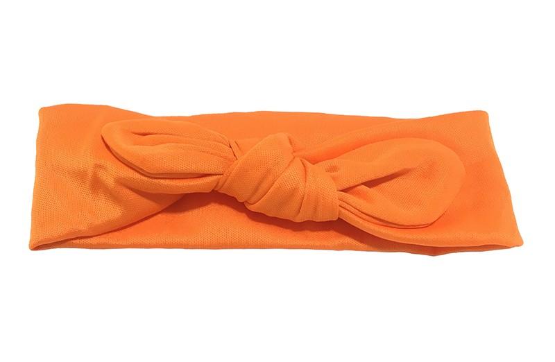 Leuk oranje baby peuter haarbandje van glanzende rekbare gladde stof. Het haarbandje is in een leuk 'konijnenoortjes model' geknoopt.  De hoogte van het haarbandje is ongeveer 5 centimeter.