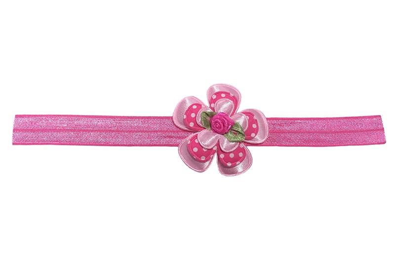 Schattig glanzend roze baby peuter haarbandje.  Met daarop een effen lichtroze bloem, een fel roze bloem met witte stippeltjes en een effen licht roze bloemetje.  Afgewerkt met een fel roze roosje.  Niet uitgerekt is het elastische bandje ongeveer 18 centimeter.