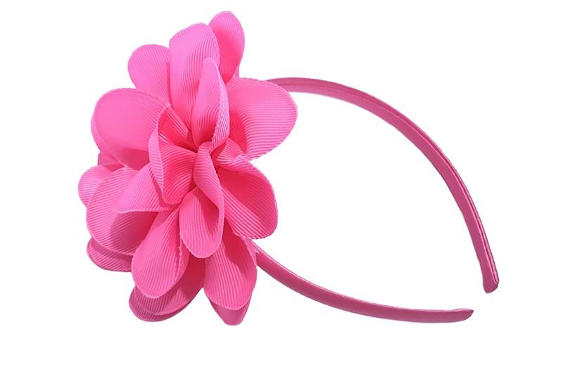 Vrolijke fel roze meisjes diadeem met een grote fel roze bloem.