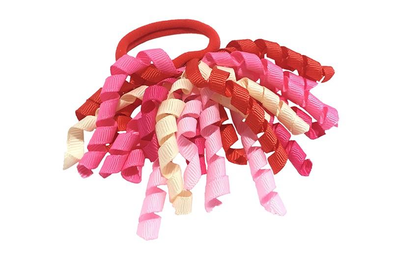 Vrolijk rood elastiek met gekrulde lintjes in rood en verschillende roze kleurtjes.  Met deze leuke elastieken altijd en heel makkelijk een vrolijk kapsel. Ook leuk per twee stuks.