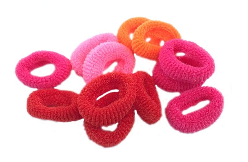 Leuk setje van 12 kleine zachte baby/peuter elastiekjes in de kleuren oranje, roze en rood.