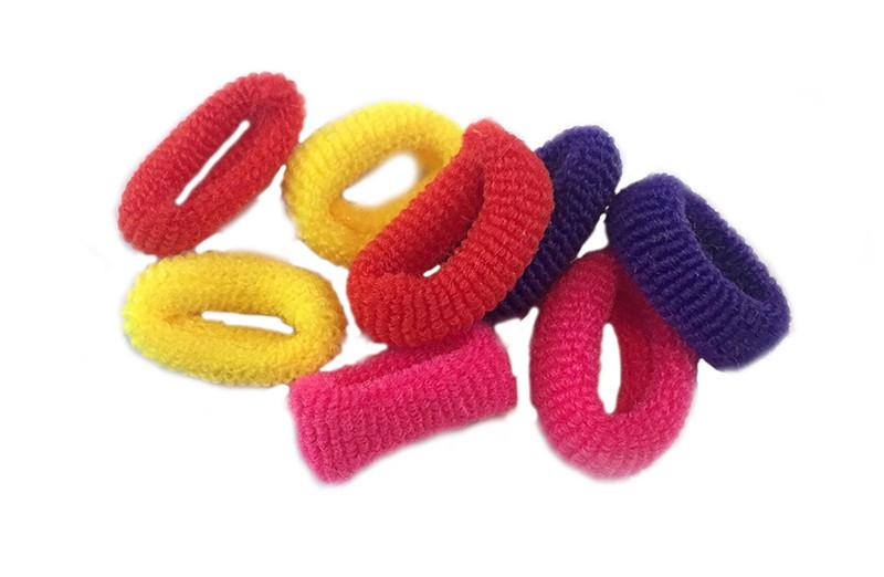 Leuk setje van 8 kleine zachte baby/peuter elastiekjes in de kleuren oranje, roze en rood.