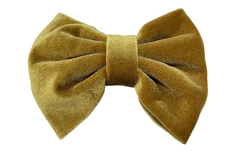 Mooie grote fluweel stoffen haarstrik goudbruin.  Van lekker zachte stof. Op een handige haarknip met tandjes van ongeveer 5.5 centimeter.