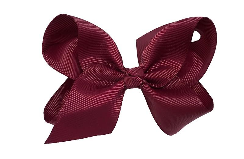 Leuke grote bordeaux rode meisjes haarstrik van lint. Op een platte haarknip van 4.5 centimeter bekleed met rood lint. De strik heeft een afmeting van ongeveer 10 centimeter.