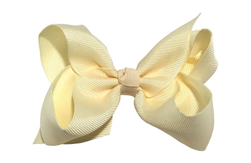 Leuke grote effen (creme) zacht gele meisjes haarstrik van lint. Op een platte haarknip van 4.5 centimeter bekleed met creme, zacht geel lint. De strik heeft een afmeting van ongeveer 10 centimeter.