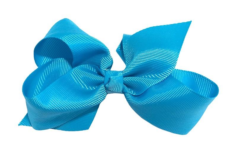 Leuke grote effen fel blauwe meisjes haarstrik van lint. Op een platte haarknip van 4.5 centimeter bekleed met fel blauw lint. De strik heeft een afmeting van ongeveer 10 centimeter.
