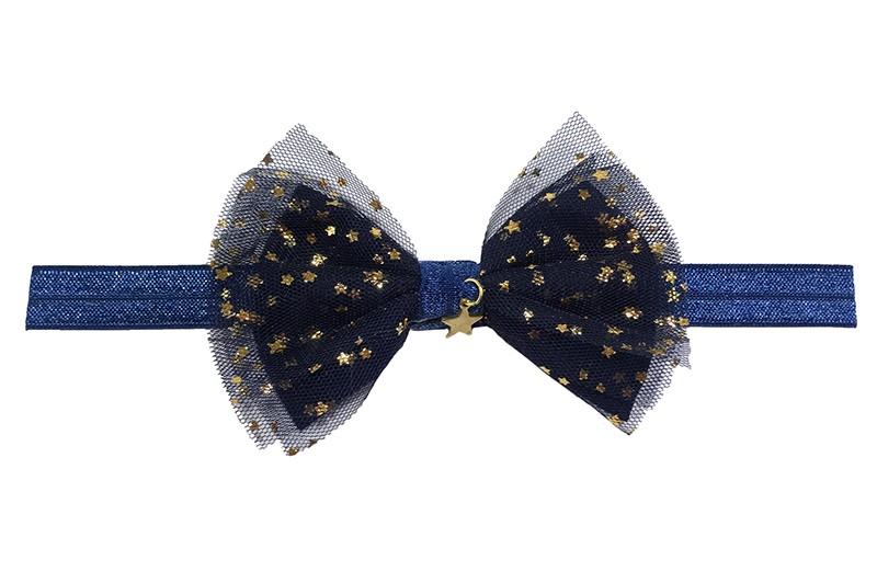 Schattig donkerblauw peuter haarbandje.  Met een donkerblauw strikje van stof en tule met kleine gouden sterretjes. En een klein glimmend hangertje in vorm van sterretje. Geschikt tot ongeveer 3 jaar.