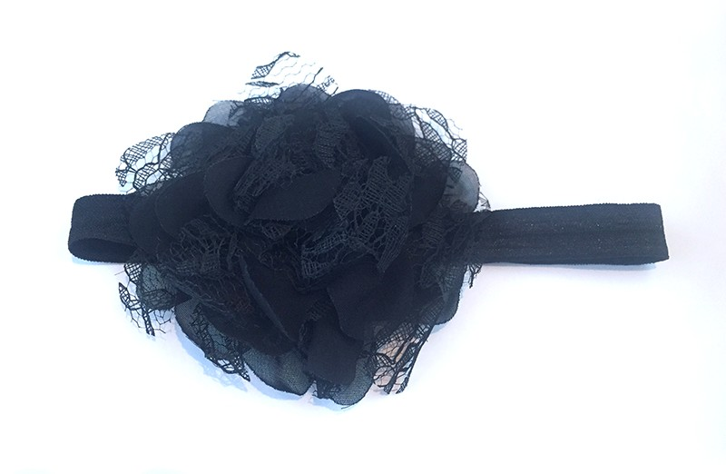 Leuke zwarte peuter / kleuter haarband met mooie zwarte bloem van stof en kant.