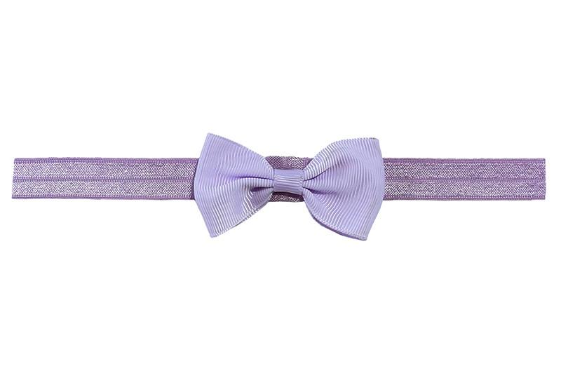 Leuk lila paars elastische baby haarbandje met een lila strikje erop.  Heeft zonder uit te rekken een omtrek van ongeveer 35 centimeter.  Geschikt tot en met ongeveer 5 jaar.