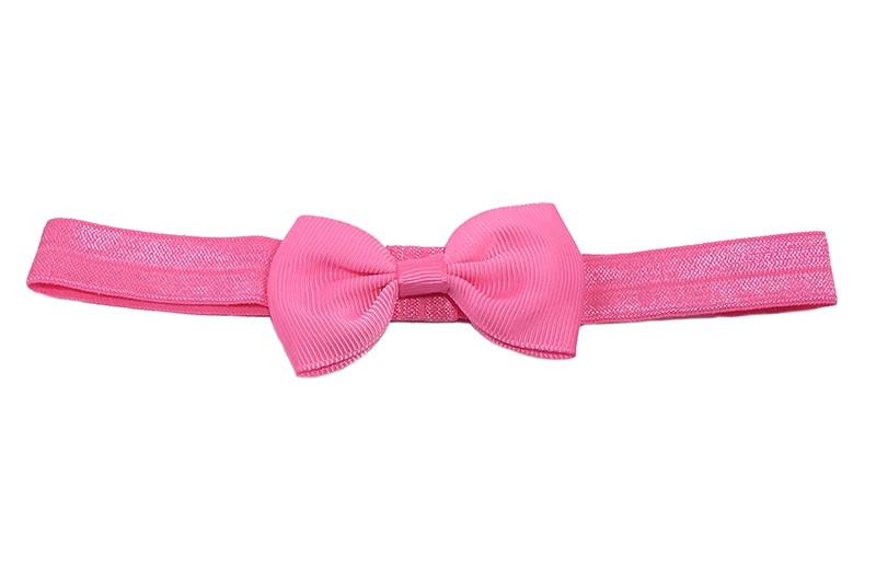 Leuke fel roze elastische baby peuter kleuter haarbandje met een fel roze strikje van lint.  Het bandje is van goed rekbaar elastiek. Daardoor geschikt tot en met ongeveer 5 jaar.