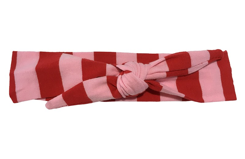 Leuk licht roze met rood gestreept baby peuter kleuter haarbandje.  Het haarbandje is van zachte rekbare stof.  Het haarbandje is makkelijk zelf te knopen, zo kun je lang plezier hebben van dit leuke haarbandje.  De breedte van het haarbandje is ongeveer 4,5 centimeter.