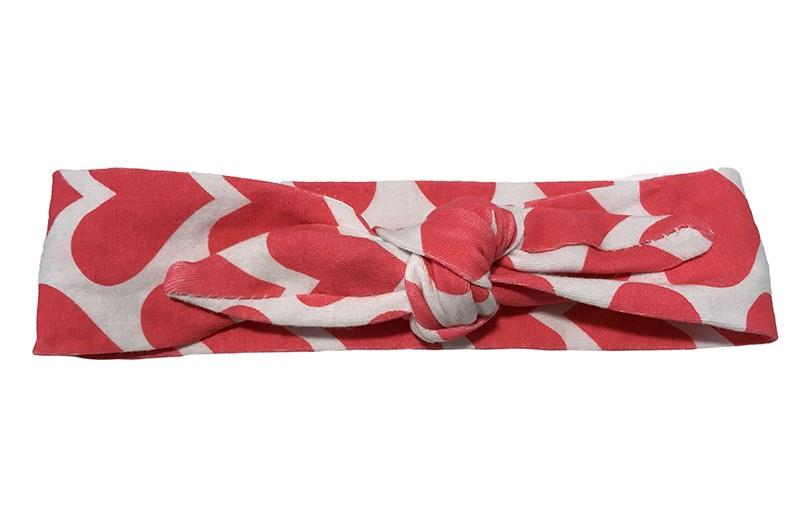 Leuk wit baby peuter kleuter haarbandje met donker fuchsia roze hartjes.  Het haarbandje is van rekbare stof en heeft een vrolijk dessin van hartjes. Het haarbandje is makkelijk zelf te knopen, zo kun je lang plezier hebben van dit leuke haarbandje.  De breedte van het haarbandje is ongeveer 4.5 centimeter.