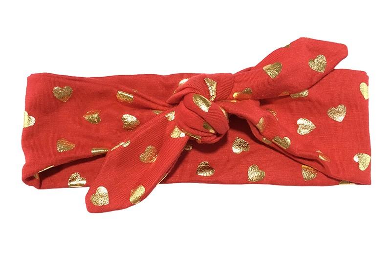 Leuk rood baby peuter kleuter haarbandje met glanzend gouden hartjes.  Het haarbandje is van zachte rekbare stof. Het haarbandje is makkelijk zelf te knopen, zo kun je lang plezier hebben van dit leuke haarbandje.  De breedte van het haarbandje is ongeveer 6 centimeter.