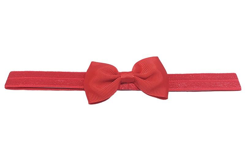Leuk rood elastische baby peuter kleuter haarbandje met een rood strikje van lint.  Het bandje is van goed rekbaar elastiek. Daardoor geschikt tot en met ongeveer 4 jaar.
