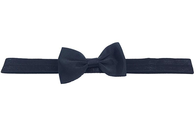 Leuk zwart elastische baby peuter kleuter haarbandje met een zwart strikje erop.  Het bandje is van fijn rekbaar elastiek, daardoor geschikt tot en met ongeveer 5 jaar.