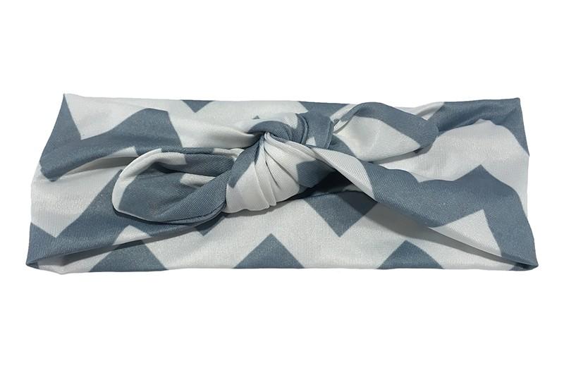 Vrolijk grijs wit baby peuter haarbandje van gladde rekbare stof met zigzag strepen. Geknoopt in leuk 'konijnenoortjes model'. De hoogte van het haarbandje is ongeveer 6 centimeter.