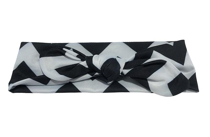 Vrolijk zwart wit baby peuter haarbandje van gladde rekbare stof met zigzag strepen. Geknoopt in leuk 'konijnenoortjes model' De hoogte van het haarbandje is ongeveer 6 centimeter.