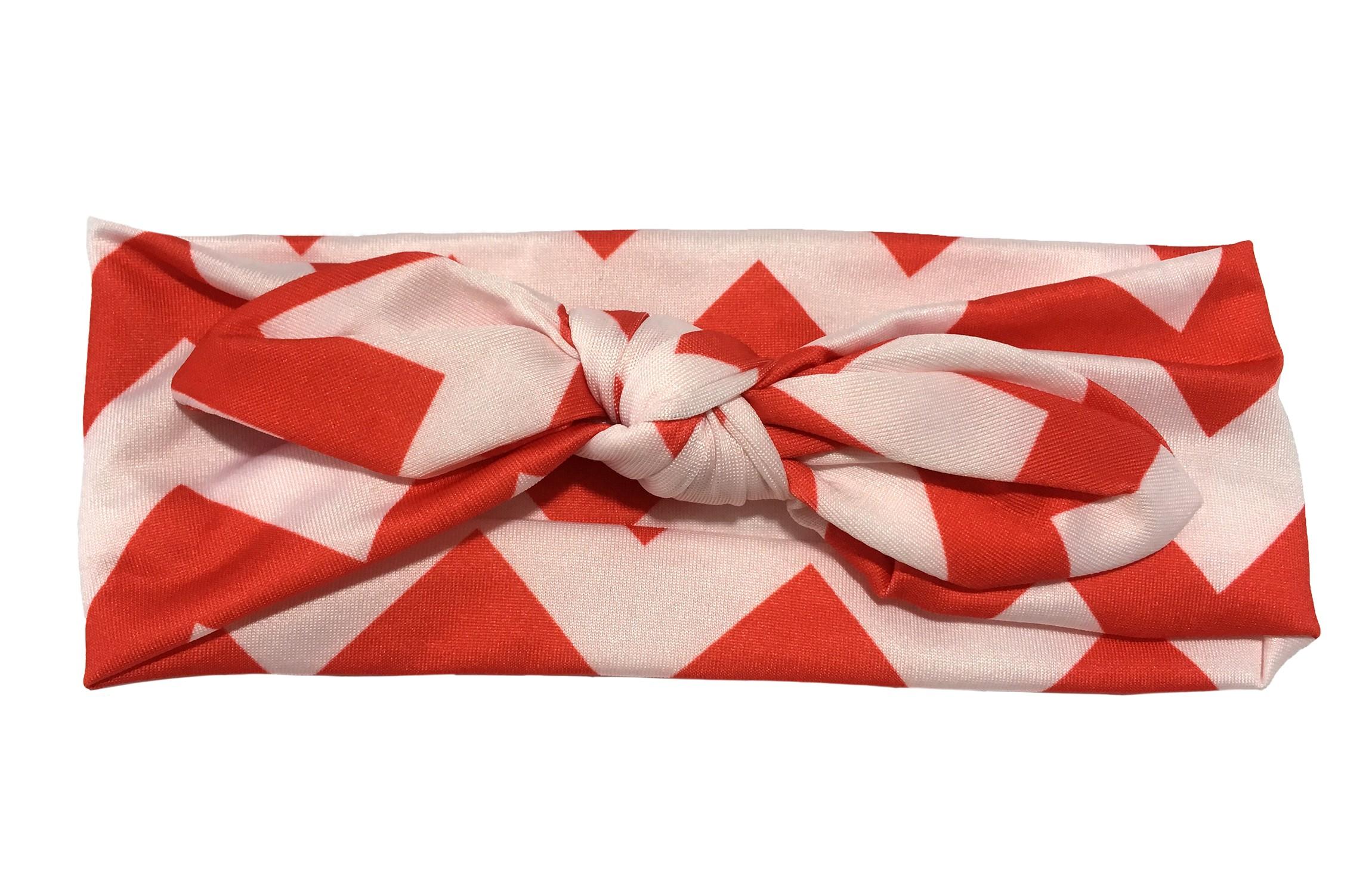 Vrolijk rood wit baby peuter haarbandje van gladde rekbare stof met zigzag strepen. Geknoopt in leuk 'konijnenoortjes model' De hoogte van het haarbandje is ongeveer 6 centimeter.