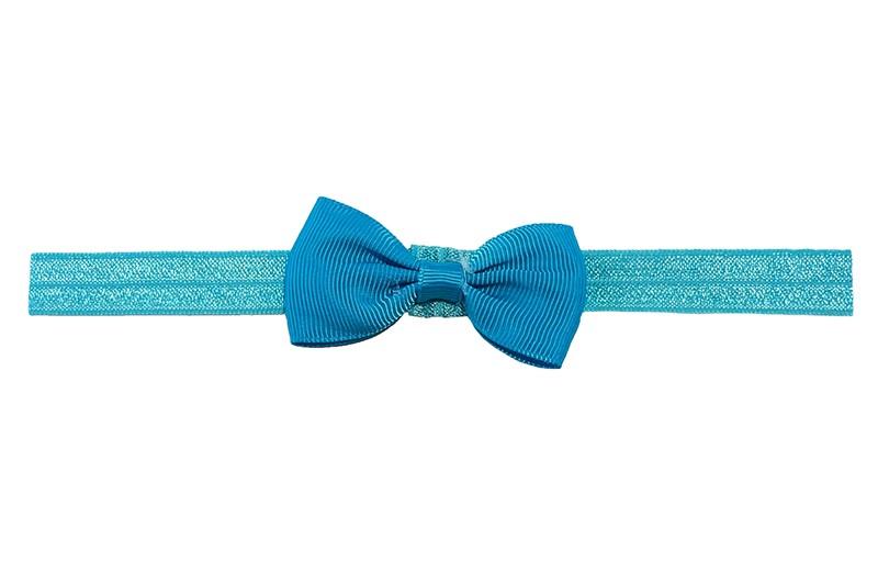 Leuk fel blauw elastische baby peuter kleuter haarbandje met een blauw strikje erop. Heeft zonder uit te rekken een omtrek van ongeveer 35 centimeter. Geschikt tot en met ongeveer 5 jaar.
