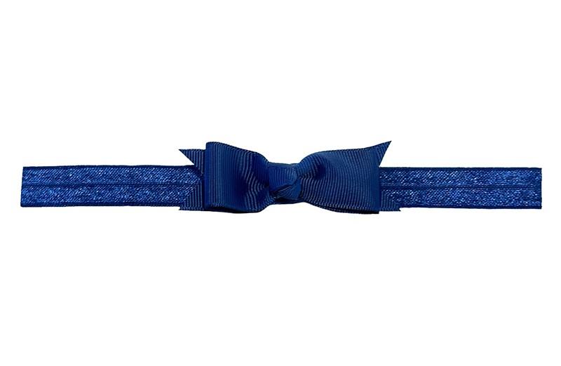 Schattig donkerblauw peuter kleuter haarbandje.  Met een donkerblauw strikje van lint.  Het haarbandje is van fijn rekbaar elastiek, geschikt tot en met ongeveer 5 jaar.