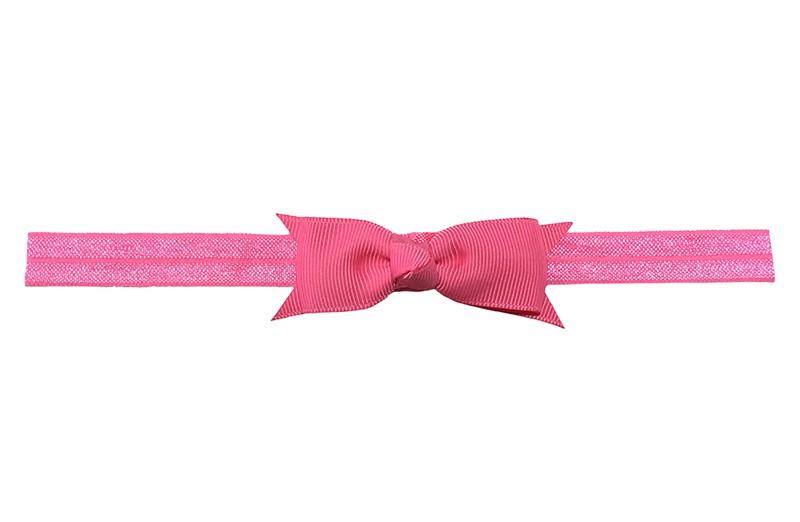Schattig fel roze peuter kleuter haarbandje.  Met een fel roze strikje van lint.  Het haarbandje is van fijn rekbaar elastiek, geschikt tot en met ongeveer 5 jaar.