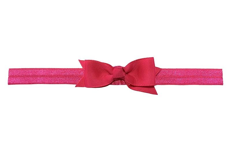 Schattig fuchsia roze peuter kleuter haarbandje.  Met een fuchsia roze strikje van lint.  Het haarbandje is van fijn rekbaar elastiek, geschikt tot en met ongeveer 5 jaar.