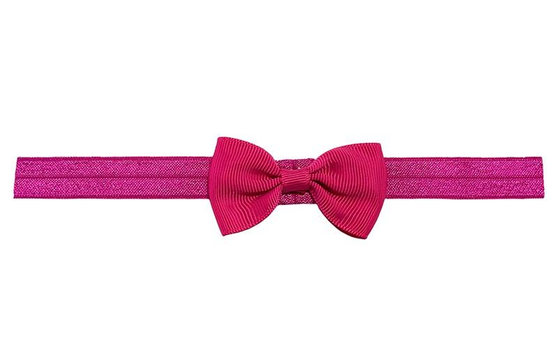 Leuk fuchsia roze elastische baby peuter kleuter haarbandje. Met een fuchsia roze strikje erop.  Heeft zonder uit te rekken een omtrek van ongeveer 35 centimeter. Geschikt tot en met ongeveer 5 jaar.