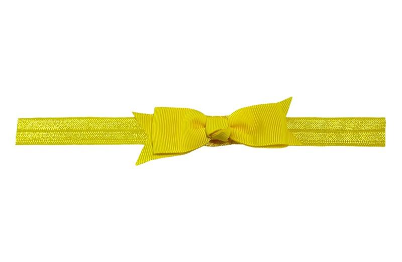 Schattig geel peuter kleuter haarbandje.  Met een geel strikje van lint.  Het haarbandje is van fijn rekbaar elastiek, geschikt tot en met ongeveer 5 jaar.