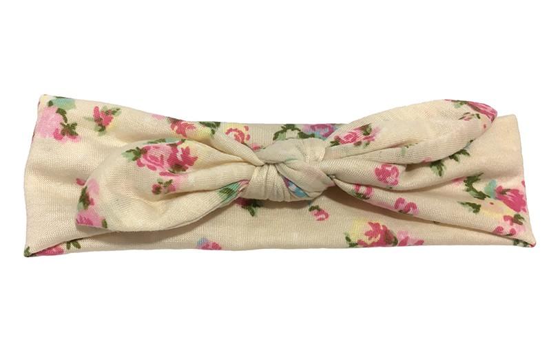 Schattig geknoopt baby, peuter, kleuter haarbandje. Van creme/zandkleurige zachte rekbare stof met vrolijke roze roosjes motief.  Het haarbandje is heel goed rekbaar en daardoor lang te gebruiken.