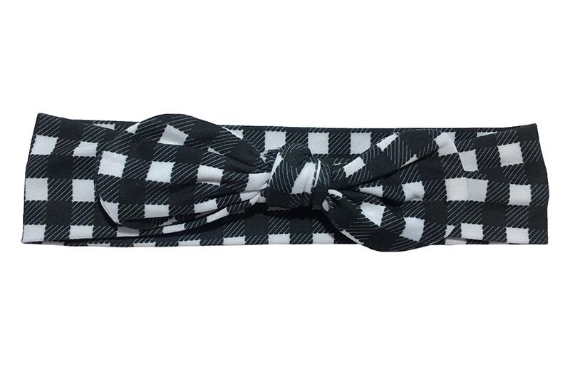 Vrolijk zwart wit geblokt peuter meisjes haarbandje.   Het haarbandje is van zachte rekbare stof geknoopt in een leuk modelletje.  Het haarbandje is niet uitgerekt ongeveer 20 centimeter.  En 5 centimeter hoog.