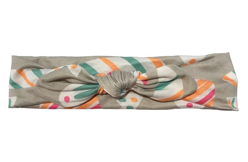 Leuk grijs stoffen baby peuter haarbandje.  Met een vrolijke gekleurde streepjes. Het haarbandje is van gladde rekbare stof.  Geknoopt in een leuk modelletje.  Het haarbandje is geschikt tot en met ongeveer 2 jaar.