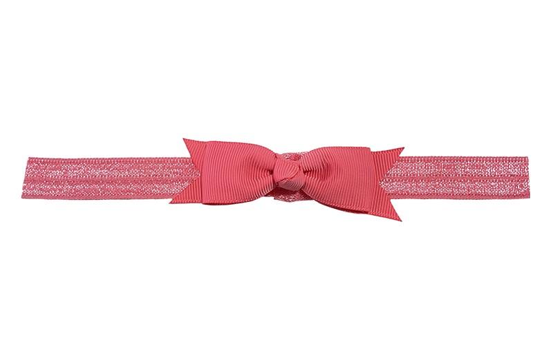 Schattig koraal roze peuter kleuter haarbandje.  Met een koraal roze strikje van lint.  Het haarbandje is van fijn rekbaar elastiek, geschikt tot en met ongeveer 5 jaar.
