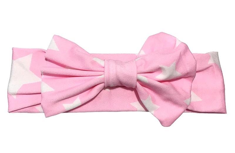 Schattig licht roze baby, peuter, meisjes haarbandje met witte sterren. Met een grote strik. Van gladde rekbare stof.  Niet uitgerekt is het haarbandje ongeveer 19 centimeter.