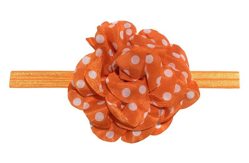 Vrolijk oranje peuter meisjes haarbandje met een grote oranje chiffon bloem met witte stippels.  Het haarbandje is van goed rekbaar elastiek, geschikt tot en met ongeveer 6 jaar.